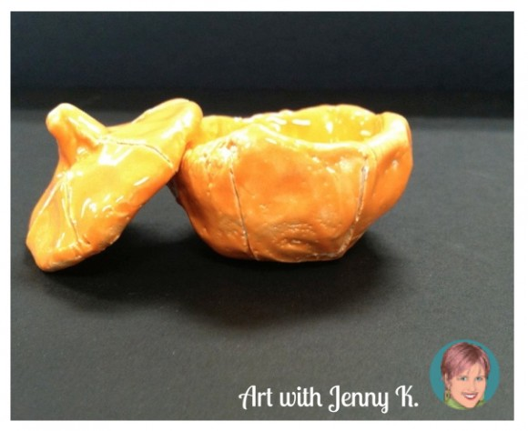 "Clay pumpkin pinch pots from ""10 Halloween Art Lessons for Kids."""