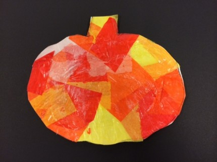 "A tissue paper pumpkin from ""10 Halloween Art Lessons for Kids."""
