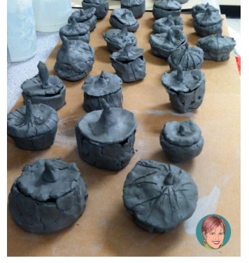"How to make clay pumpkin pinch pots from ""10 Halloween Art Lessons for Kids."""